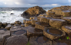 Giant`s Causeway, Northern Ireland. Giant`s Causeway is a tourist hot spot in the Northern Ireland. The area is a geological curiosity built up by interlocking stock images