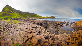 Giant's Causeway Panorama. Panoramic view at the rocky coastline of the Giant's Causeway in Northern Ireland Stock Image
