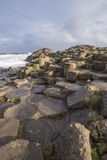 Giant`s causeway. Vertical view of hexagon-shaped basalt rocks at Giant`s Causeway in Northern Ireland stock images