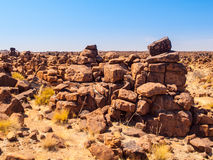 Giant`s Playground rock formations near namibian Keetmanshoop. Giant`s Playground rock formations on sunny day with clear blue sky near Keetmanshoop, Namibia Royalty Free Stock Photos