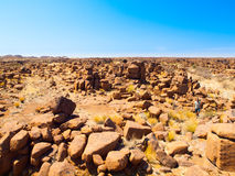 Giant`s Playground rock formations near namibian Keetmanshoop. Giant`s Playground rock formations on sunny day with clear blue sky near Keetmanshoop, Namibia Royalty Free Stock Photo