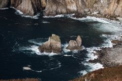 The Giant`s table and chair. Irish Cliff along Donegal`s coast as it meets the Atlantic ocean. stock images