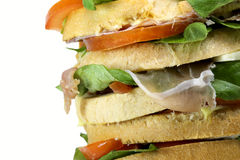Giant sandwich stuffed with many layers of bread with lettuce to Royalty Free Stock Images