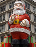 Giant Santa Claus on building royalty free stock images