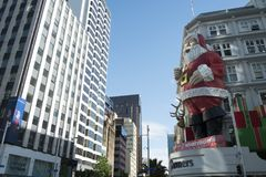 Giant Santa figure Auckland, NZ. A giant santa figure in front of Farmers store in Auckland, New Zealand stock image