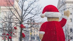 Giant Santa statue in the middle of the street in Baixa Chiado, Lisbon, Portugal royalty free stock photo