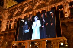Giant screen outside the historic building of the Vienna State Opera Royalty Free Stock Image