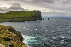 Giant  sea cliff and sea stacks on Faroe Islands Stock Images