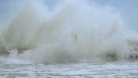 Giant Sea Waves Fall on Waterfront. Slow Motion.2mov stock video