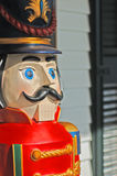 Giant size toy wooden soldier. Closeup of vintage (Victorian)  wooden toy soldier (5 feet tall) Christmas porch decoration Royalty Free Stock Images