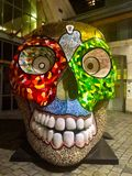 Giant skull sculpture. Red green gold Royalty Free Stock Photo