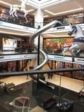 Giant slide in Mall of Berlin. A giant slide and decorative hanging horse figures in the Mall of Berlin, Germany Stock Images