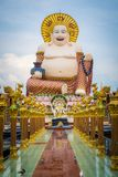 Giant smiling or happy buddha statue in buddhist temple  wat pl Royalty Free Stock Image