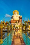 Giant happy buddha Samui. Giant smiling or happy buddha statue in Wat Plai Laem Temple, Samui, Thailand in a summer day stock photos