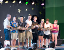 Giant Snake on stage at animal show. Audience members and a naturalist from Granite State Zoos hold a giant snake at a show at Canobie Lake Park in New Hampshire royalty free stock photo