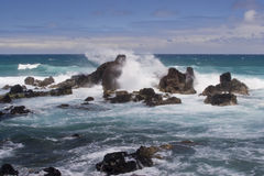 Giant Splash at Rocky Shore Stock Photo