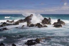 Giant Splash at Rocky Shore Stock Photo