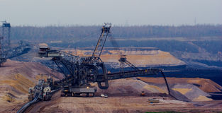 Giant spreader in an open pit Stock Images
