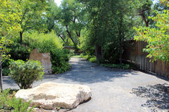Giant Square Boulder on the Path. A giant square boulder lies on the path at the zoo Royalty Free Stock Images