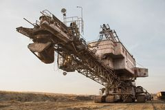 Giant stacker. Bucket chain excavator in a sand quarry. Bulk material handling.  royalty free stock photos