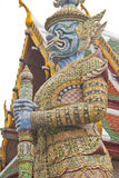 Giant statue. Temple of the Emerald Buddha (Wat Phra Kaew), Bangkok, Thailand Royalty Free Stock Photo