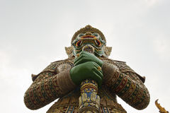 Giant statue. Temple of the Emerald Buddha (Wat Phra Kaew), Bangkok, Thailand Royalty Free Stock Images