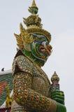 Giant statue. Temple of the Emerald Buddha (Wat Phra Kaew), Bangkok, Thailand Royalty Free Stock Photos