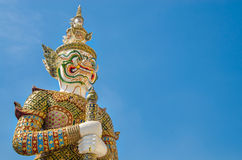 Giant statue. In emerald temple with blue sky Royalty Free Stock Images