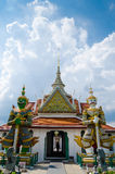 Giant Statue is The Art of Wat Arun Monastery at Bangkok. Royalty Free Stock Photography