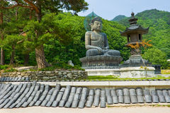 Giant statue of Buddha and memorial plates in the Sinheungsa. Temple in Seoraksan National Park, South korea Royalty Free Stock Photography