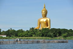 Giant statue of Buddha at Wat Muang, Thailand. ANGTHONG, THAILAND - JUNE 19: Giant statue of Buddha sits peacefully at Wat Muang temple on June 19, 2010 in Royalty Free Stock Photos