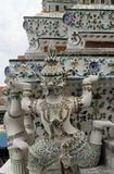 Giant statue carrying thr pagoda at Wat Arun temple of the dawn Royalty Free Stock Images