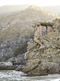 The giant statue cinque terra. The giant rock carved statue cinque terra italy Royalty Free Stock Image