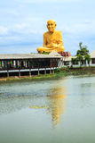 Giant statue of famous thai monk and the reflection Stock Photos
