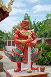 Giant statue a guard fornt off the temple gate royalty free stock photography