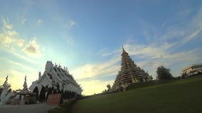 Giant statue of Quan Yin goddess at Wat Huay Plakang Temple and Ubosot, Vihara Phob Chok on blue sky background. stock footage