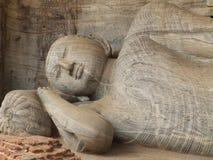 Giant statue of sleeping Buddha. Sri Lanka. Giant statue of sleeping Buddha in Sri Lanka Royalty Free Stock Images