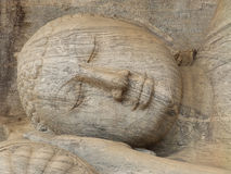 Giant statue of sleeping Buddha. Sri Lanka. Giant statue of sleeping Buddha in Sri Lanka Stock Photo