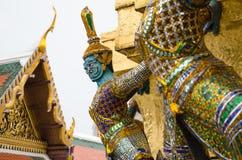 Giant Statue Surround The Basement of Grand Gold Stupa Is One of Landmark of Wat Phra Kaew Monastery, Bangkok of Thailand. Stock Photography