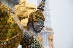 Giant Statue Surround The Basement of Grand Gold Stupa Is One of Landmark of Wat Phra Kaew Monastery, Bangkok of Thailand. Stock Image