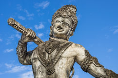 Giant Statue with Sword. Frontal view of the upper part of a giant statue with sword in the Sculpture Park near Nong Khai, Thailand Royalty Free Stock Photography
