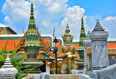 Giant statue of the Temple of the Emerald Buddha Wat Phra Kaew royalty free stock photography