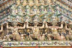 Giant statues around the base Chedi Wat Arun Stock Photo