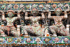 Giant statues around the base Chedi Wat Arun Stock Images