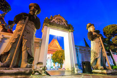 Giant statues at Wat Pho Stock Photo