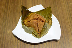 Giant sticky rice dumplings. Served in a restaurant in conjunction with Duanwu or Dragon Boat Festival royalty free stock photo