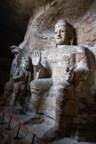 Giant Stone Buddha Sculptures. Giant stone Buddha scultpures in one of the main caves at the Yungang Grottos Stock Images