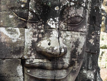Giant Stone Face at Bayon Temple in Angkor, Cambodia Stock Photo