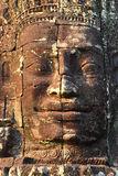 Giant stone face at Bayon Temple in Cambodia Royalty Free Stock Photo