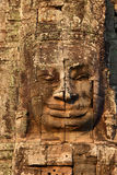 Giant stone face at Bayon Temple in Cambodia Stock Photo